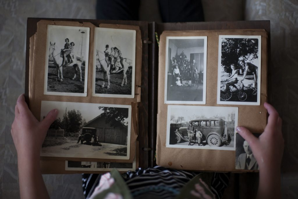 Photo album containing old pictures in black and white.